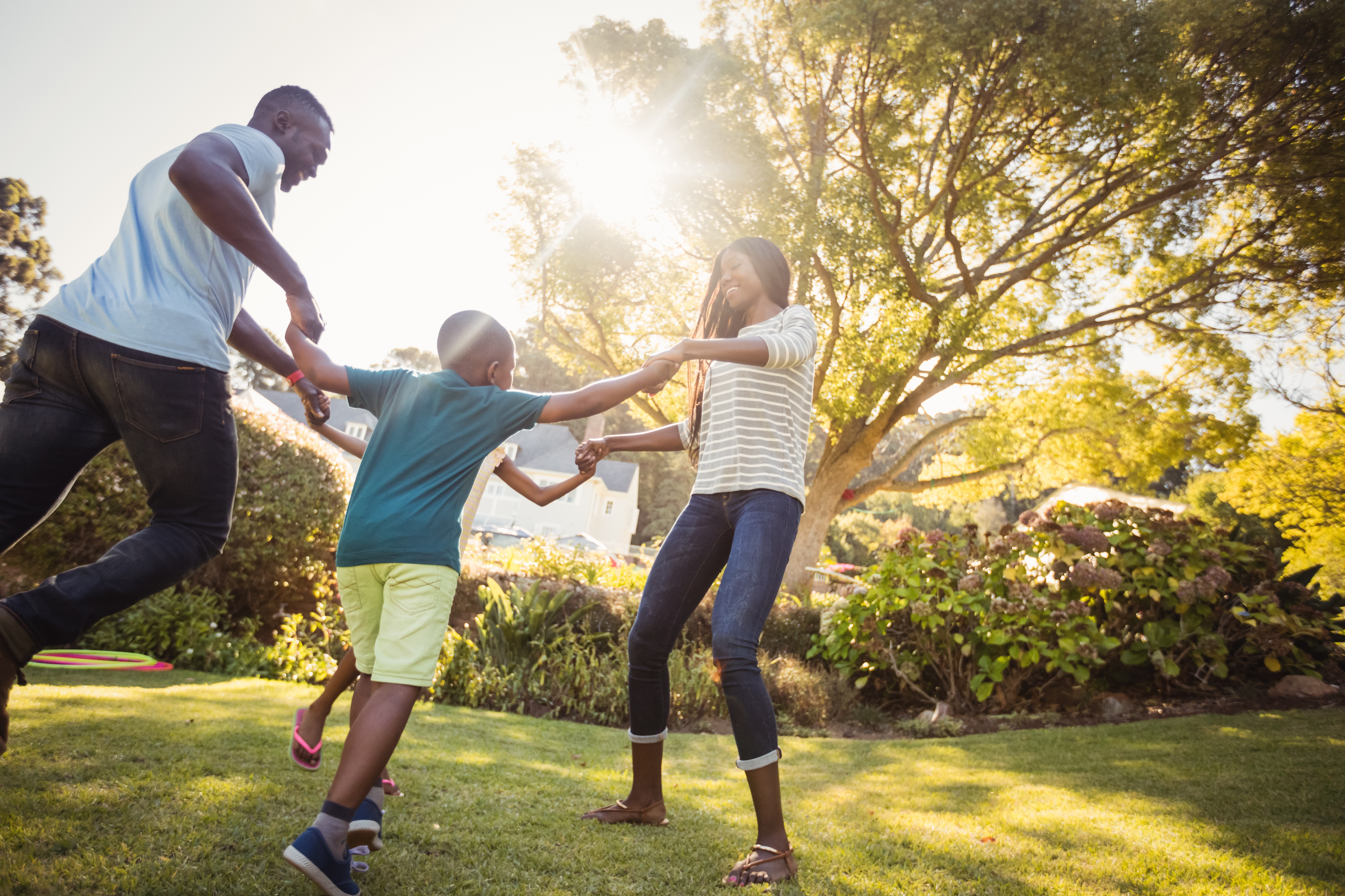 family playing in a backyard
