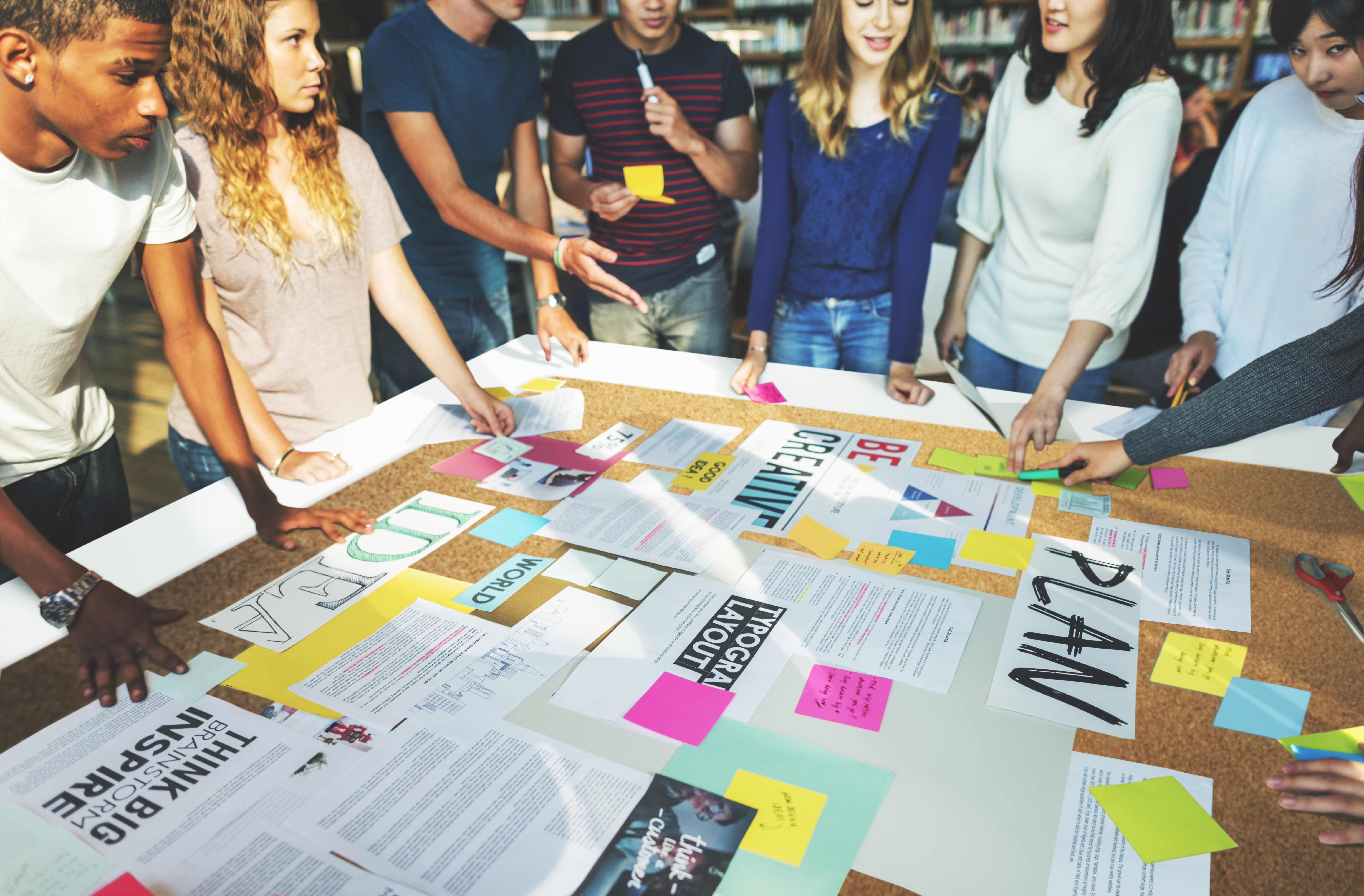 a group collaborates around a table