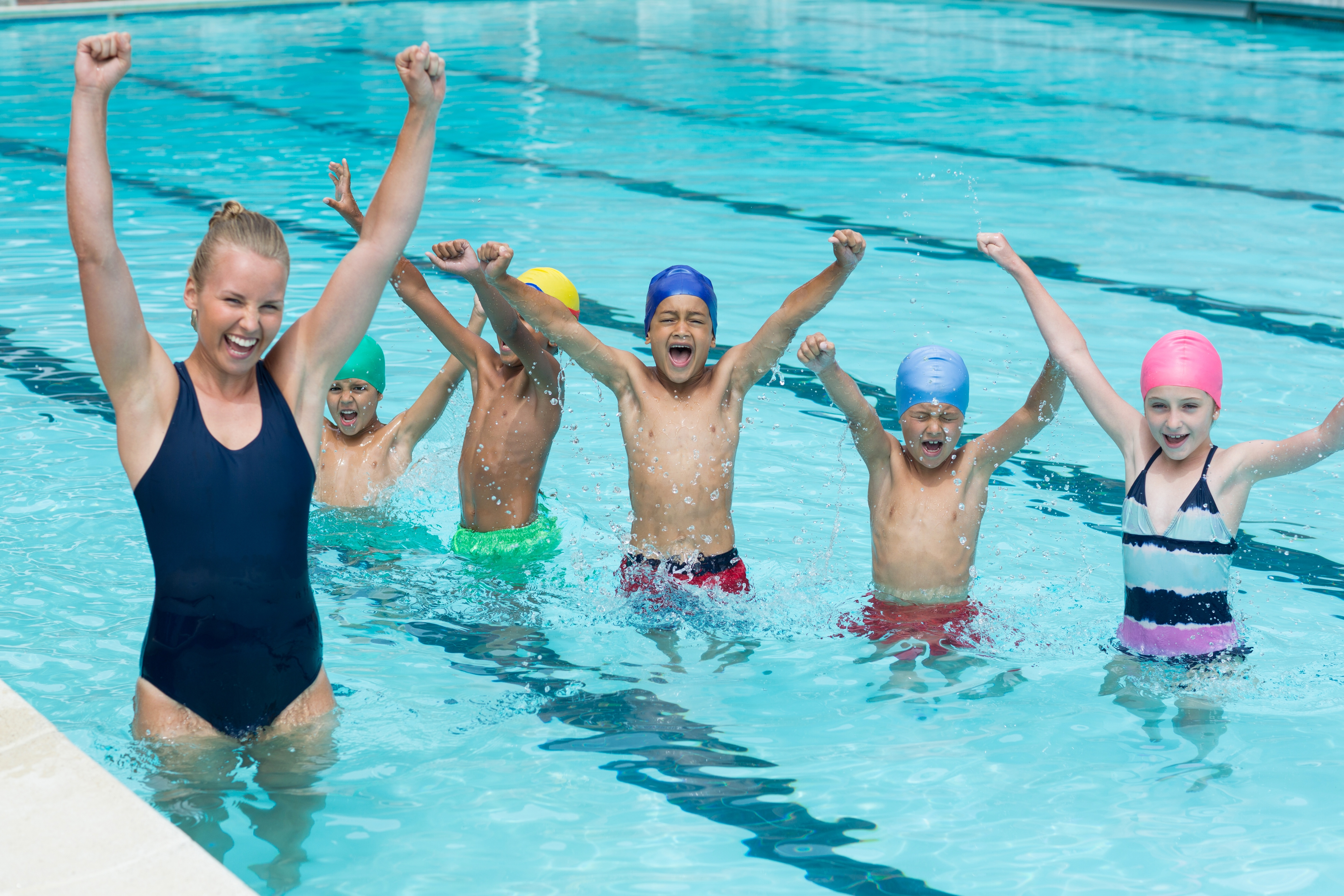 coach with young swimmers