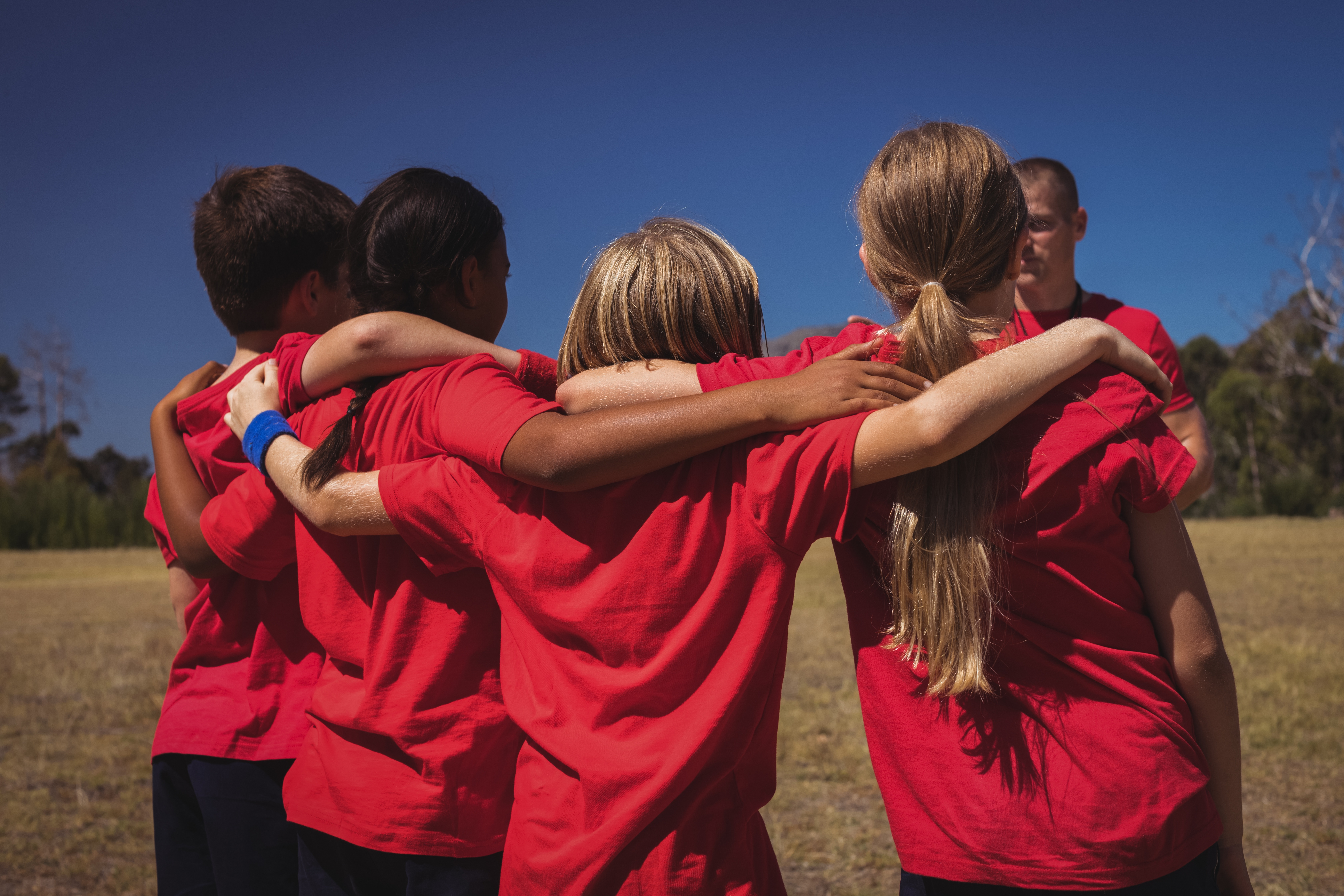 youth in team huddle