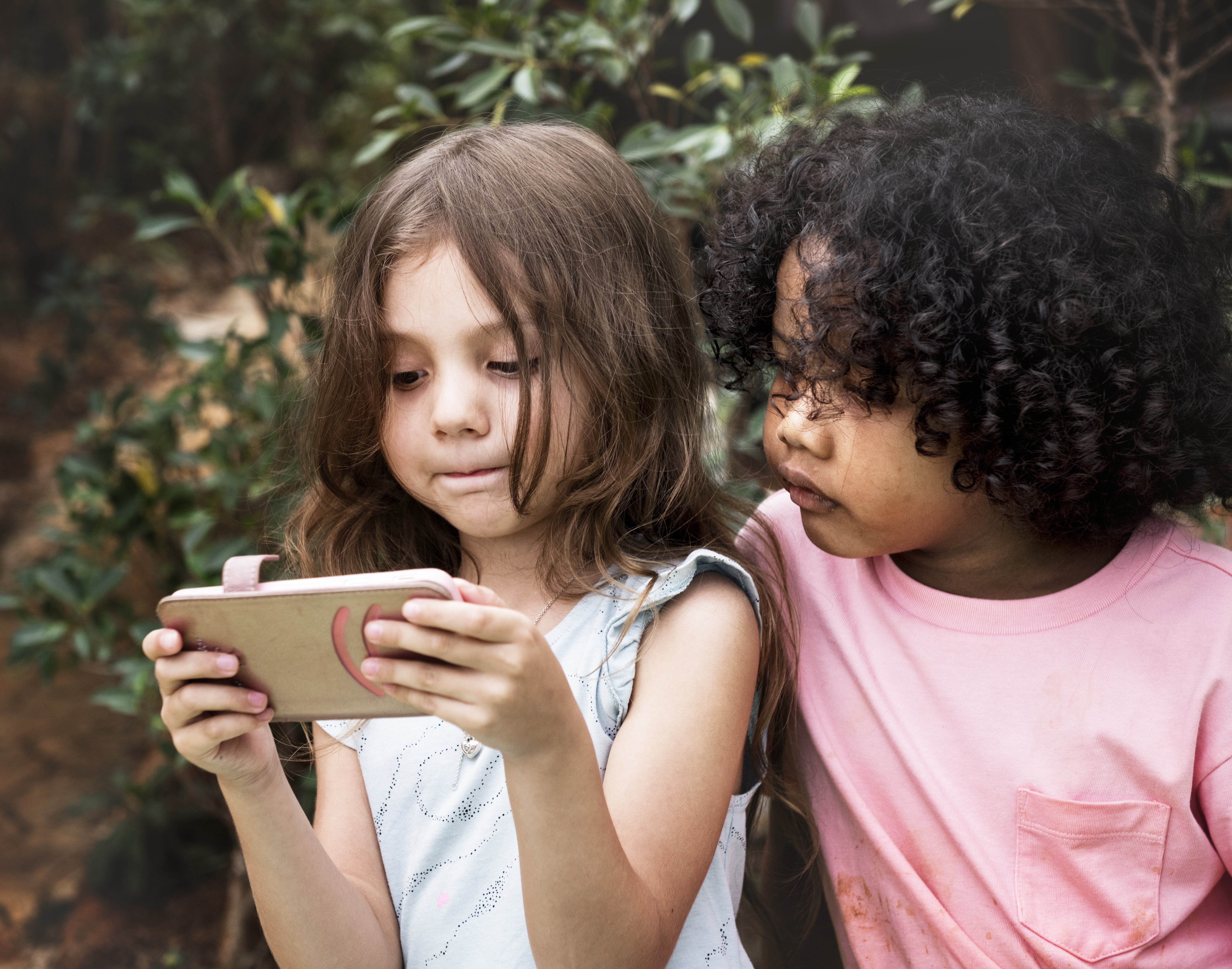 kids looking at a phone