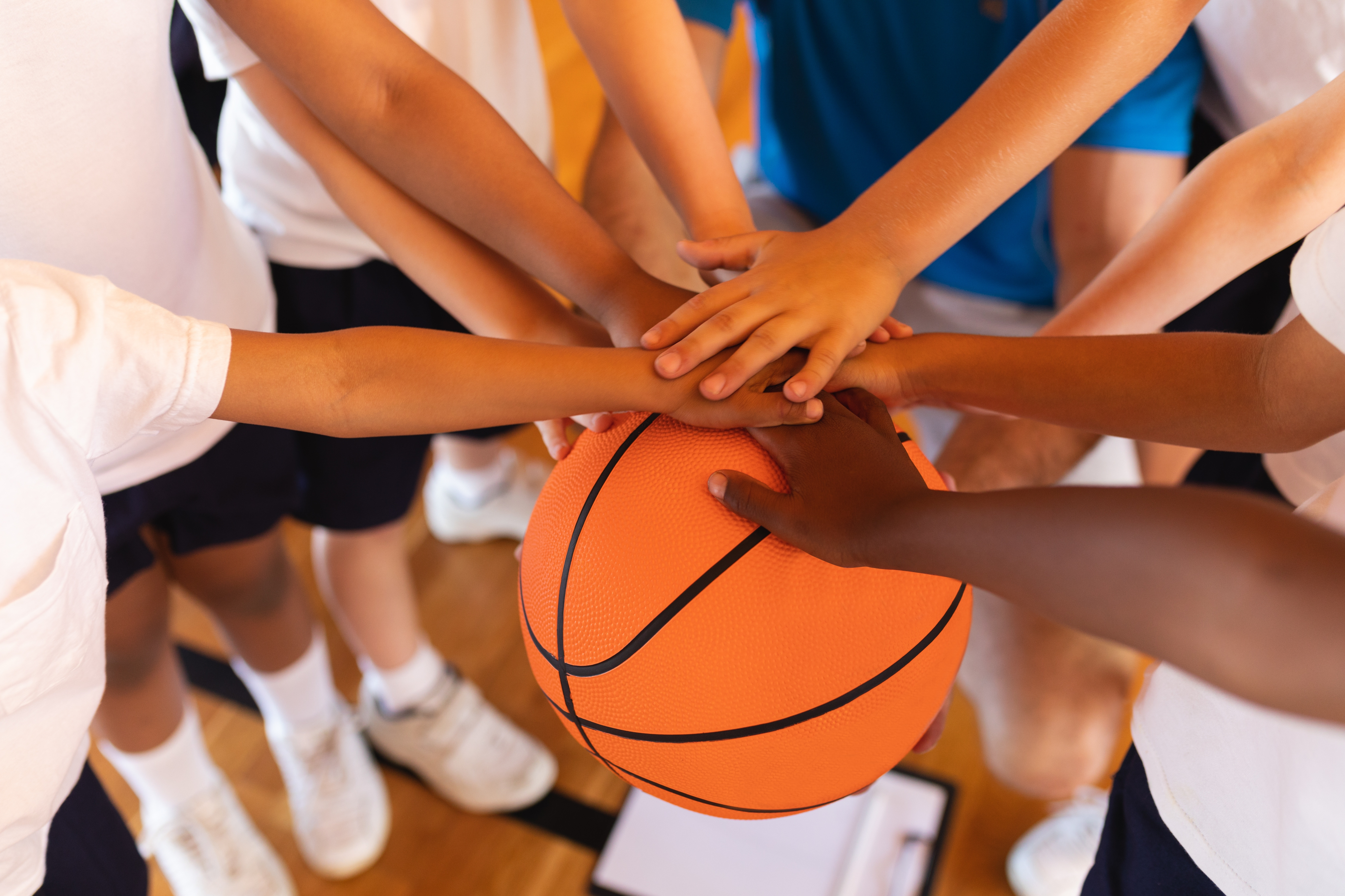 Group of hands on a basketball