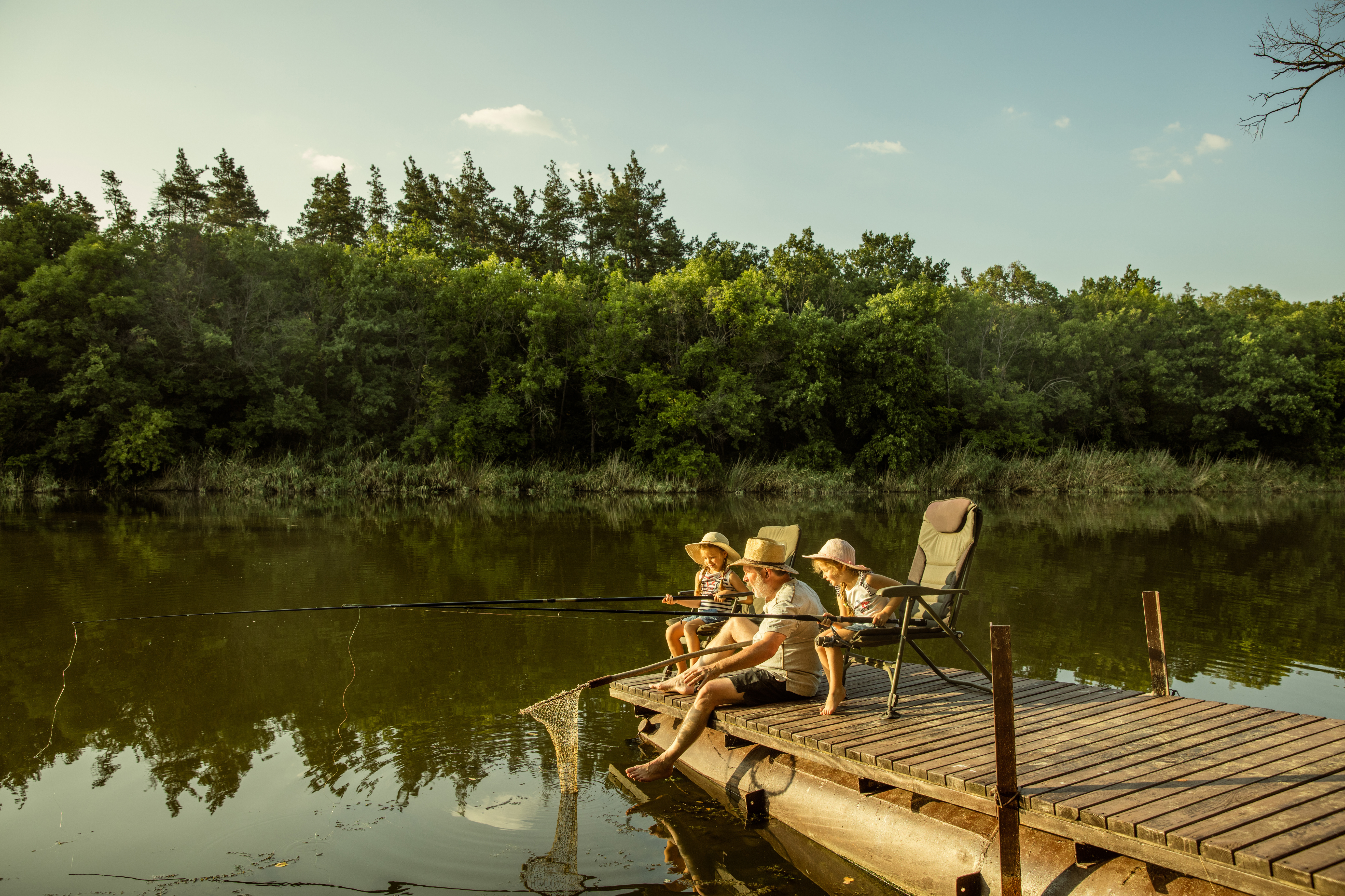 family fishing off a dock