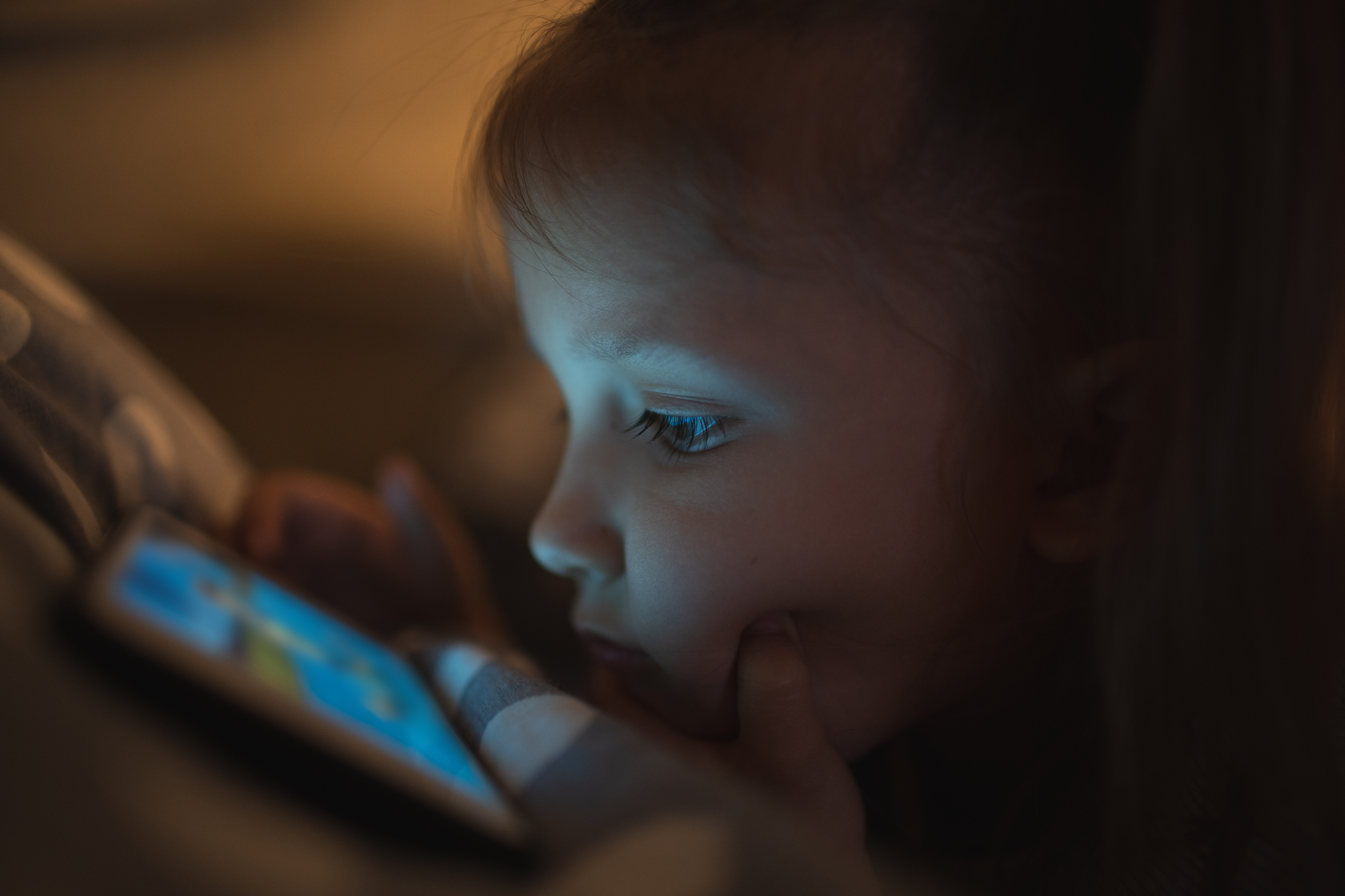 child staring at a screen