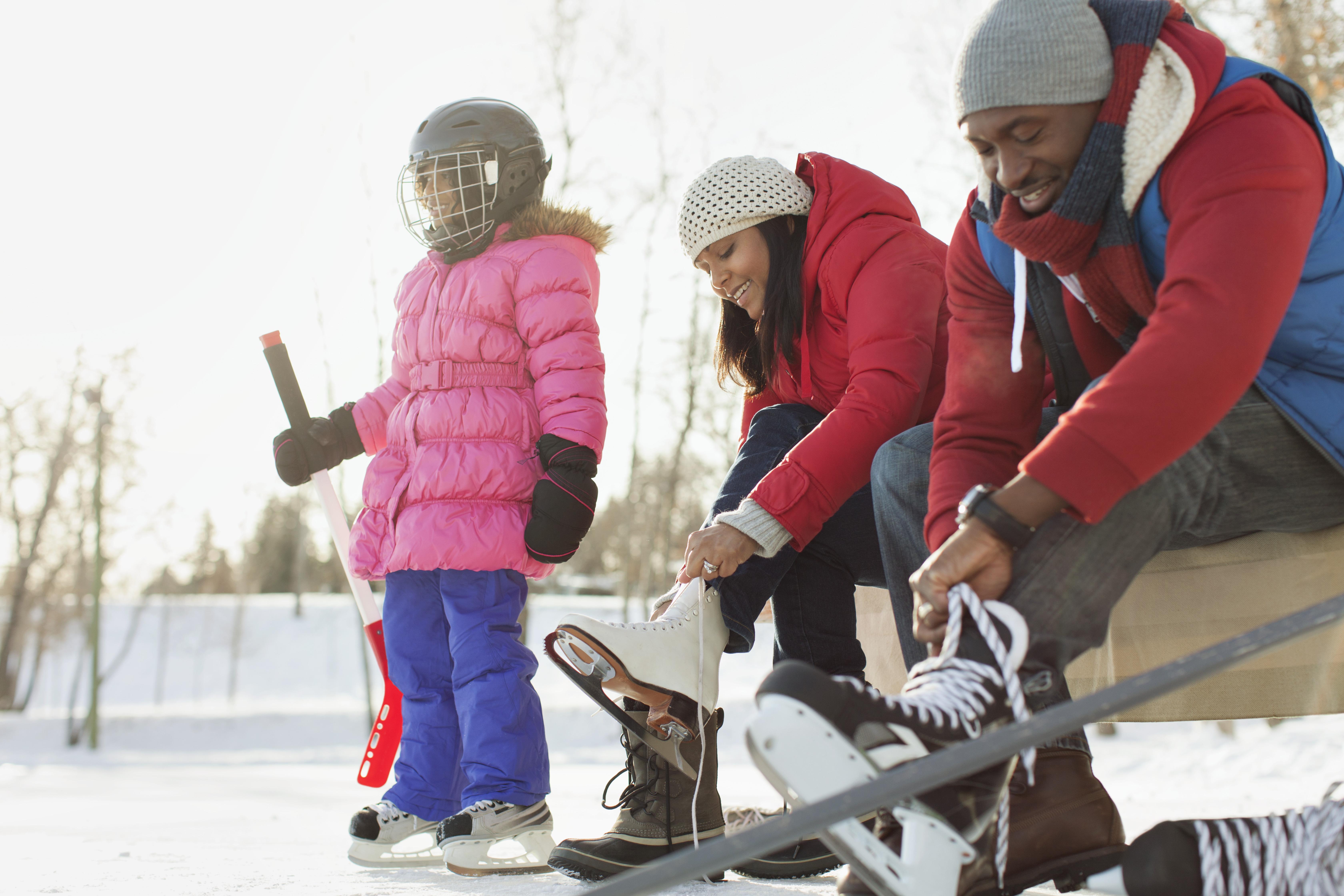 family preparing to ice skate