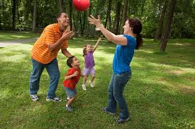 image of family playing outside